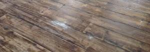 T&J Painting Solutions preparing wooden floor